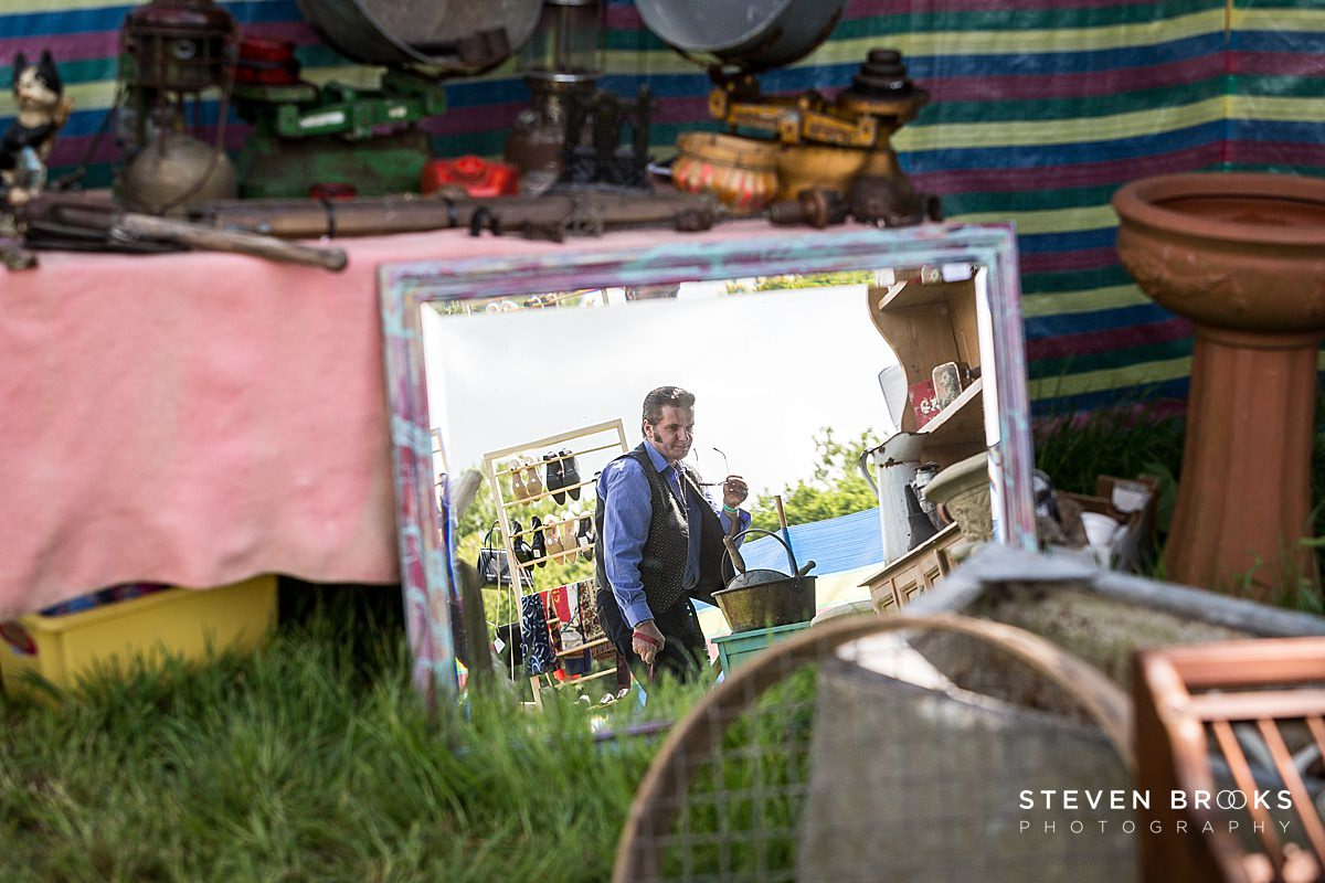Norfolk photographer steven brooks photographs Britain Does Vintage at Stody Lodge reflection of man in old mirror