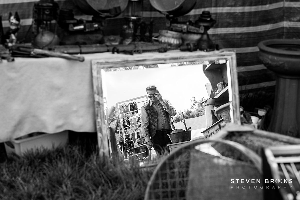 Norfolk photographer steven brooks photographs Britain Does Vintage at Stody Lodge man reflected in mirror