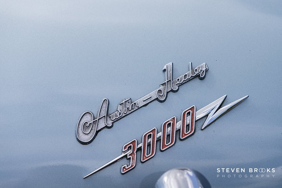 Norfolk photographer steven brooks photographs a close up of a vintage car badge at Britain Does Vintage at Stody Lodge