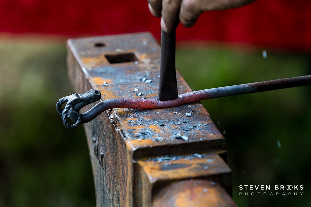 Norfolk photographer steven brooks photographs the blacksmith and his anvil at Britain Does Vintage at Stody Lodge