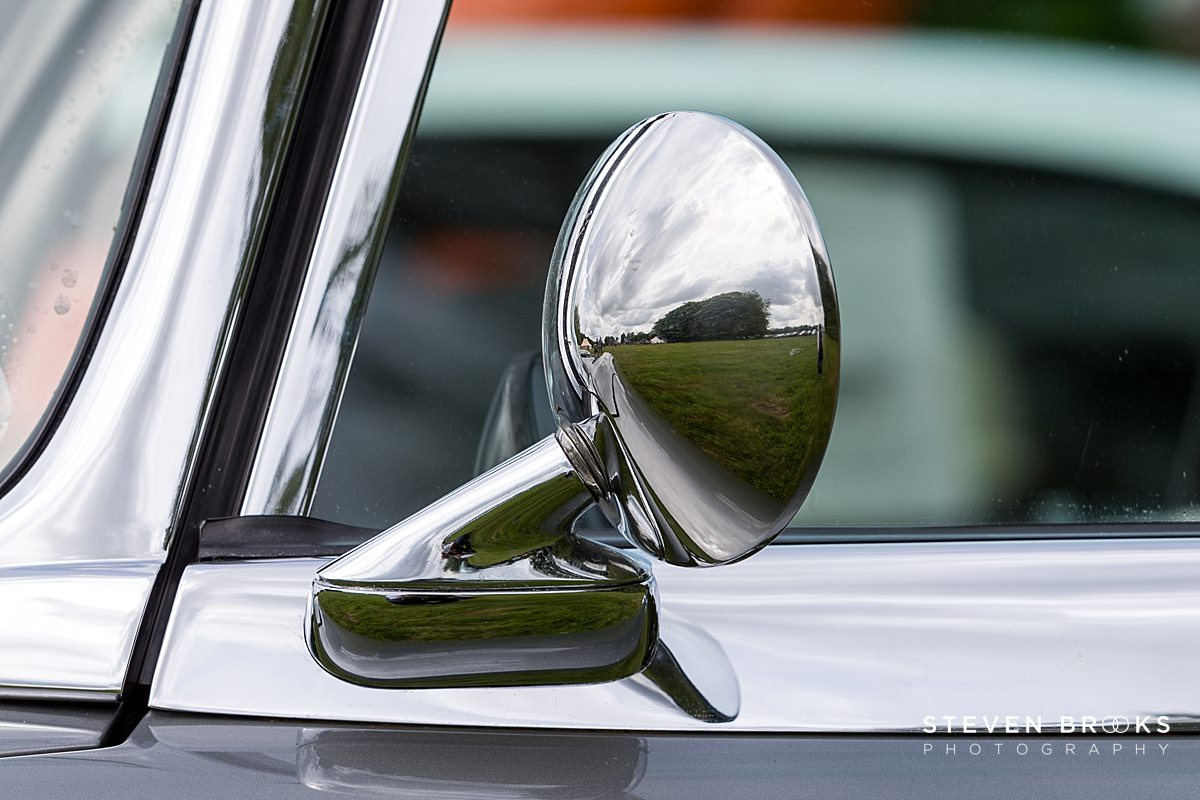 Norfolk photographer steven brooks photographs a close up of vintage car wing mirror at Britain Does Vintage at Stody Lodge