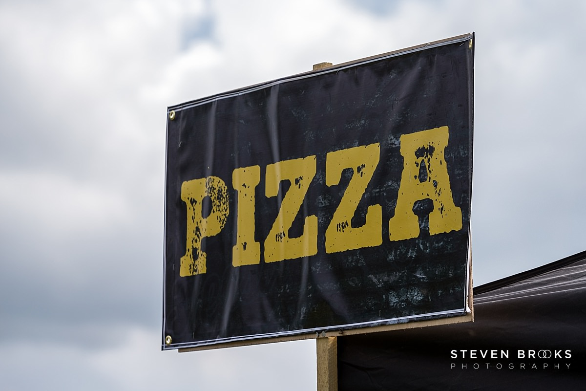 Norfolk photographer steven brooks photographs a pizza sign at Britain Does Vintage at Stody Lodge
