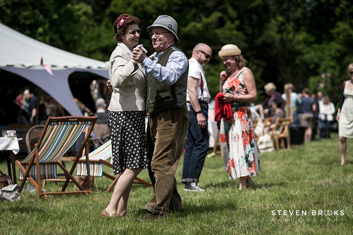 Norfolk photographer steven brooks photographs a couple dancing in vintage clothes at Britain Does Vintage at Stody Lodge