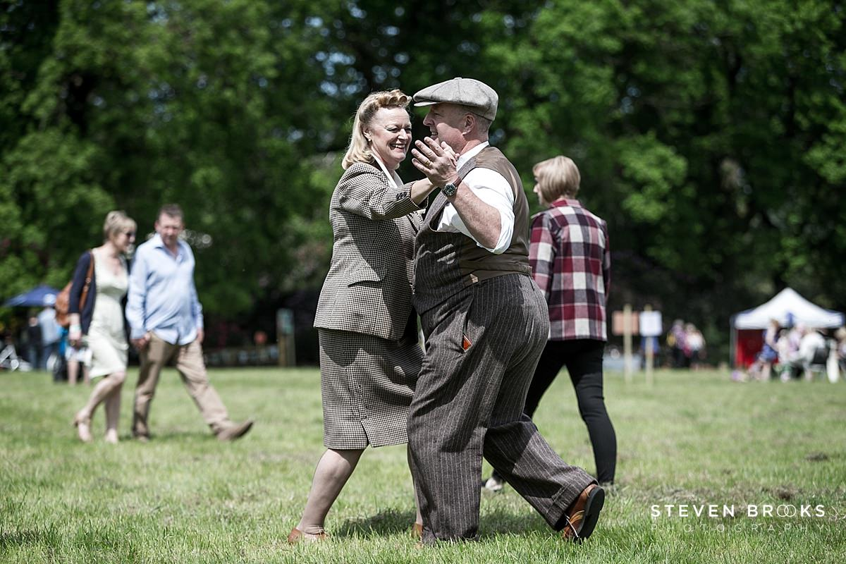 Norfolk photographer steven brooks photographs a couple dancing a waltz in vintage clothes at Britain Does Vintage at Stody Lodge