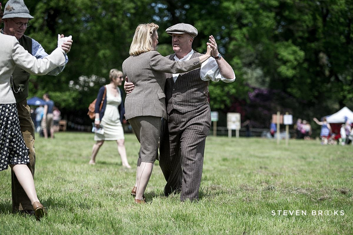 Norfolk photographer steven brooks photographs a couples dancing in vintage clothes at Britain Does Vintage at Stody Lodge