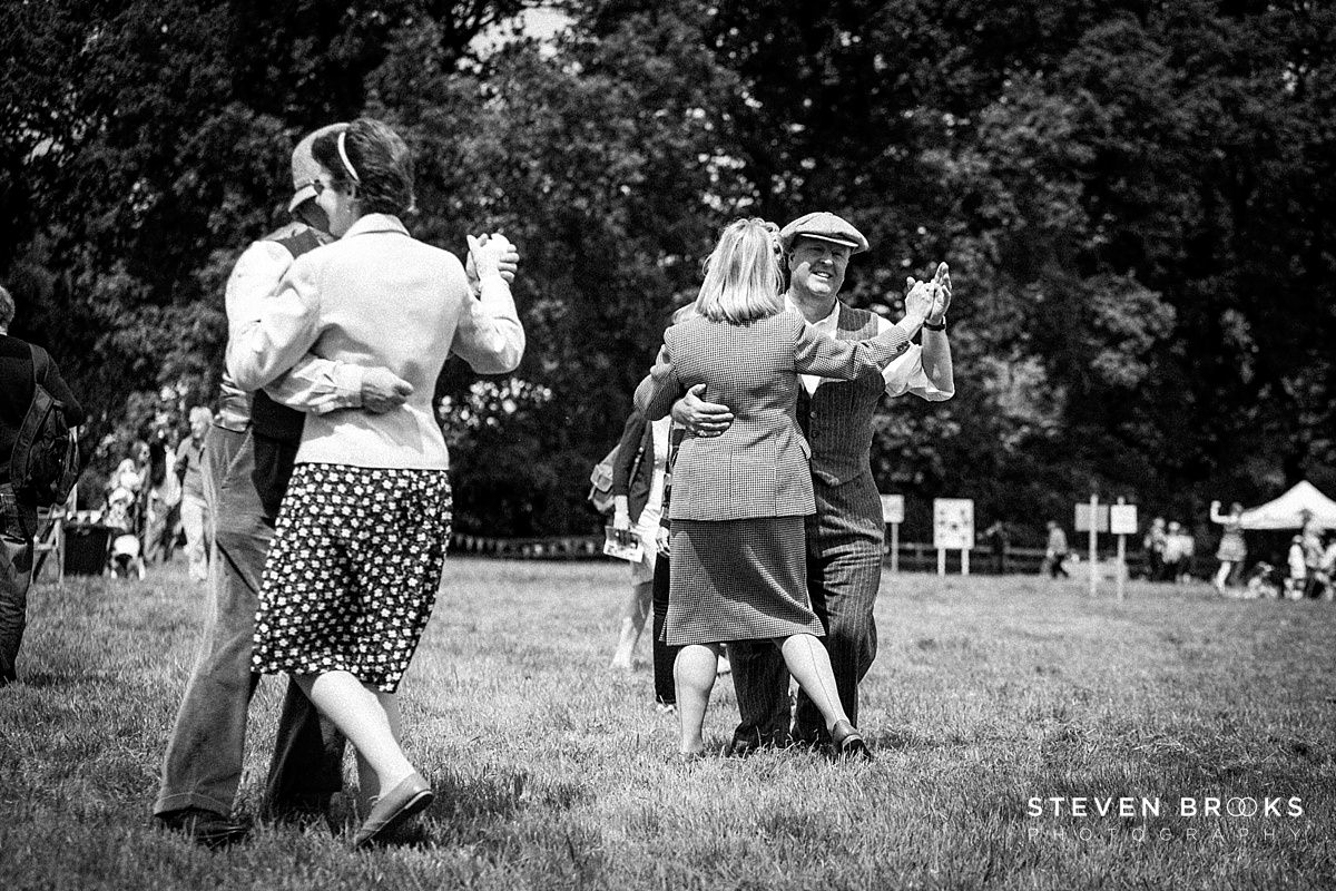Norfolk photographer steven brooks photographs a couple dancing in vintage clothes at Britain Does Vintage at Stody Lodge in black and white