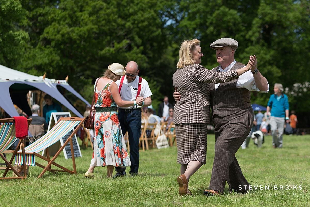 Norfolk photographer steven brooks photographs a couples dancing in vintage clothes to 40's style music at Britain Does Vintage at Stody Lodge