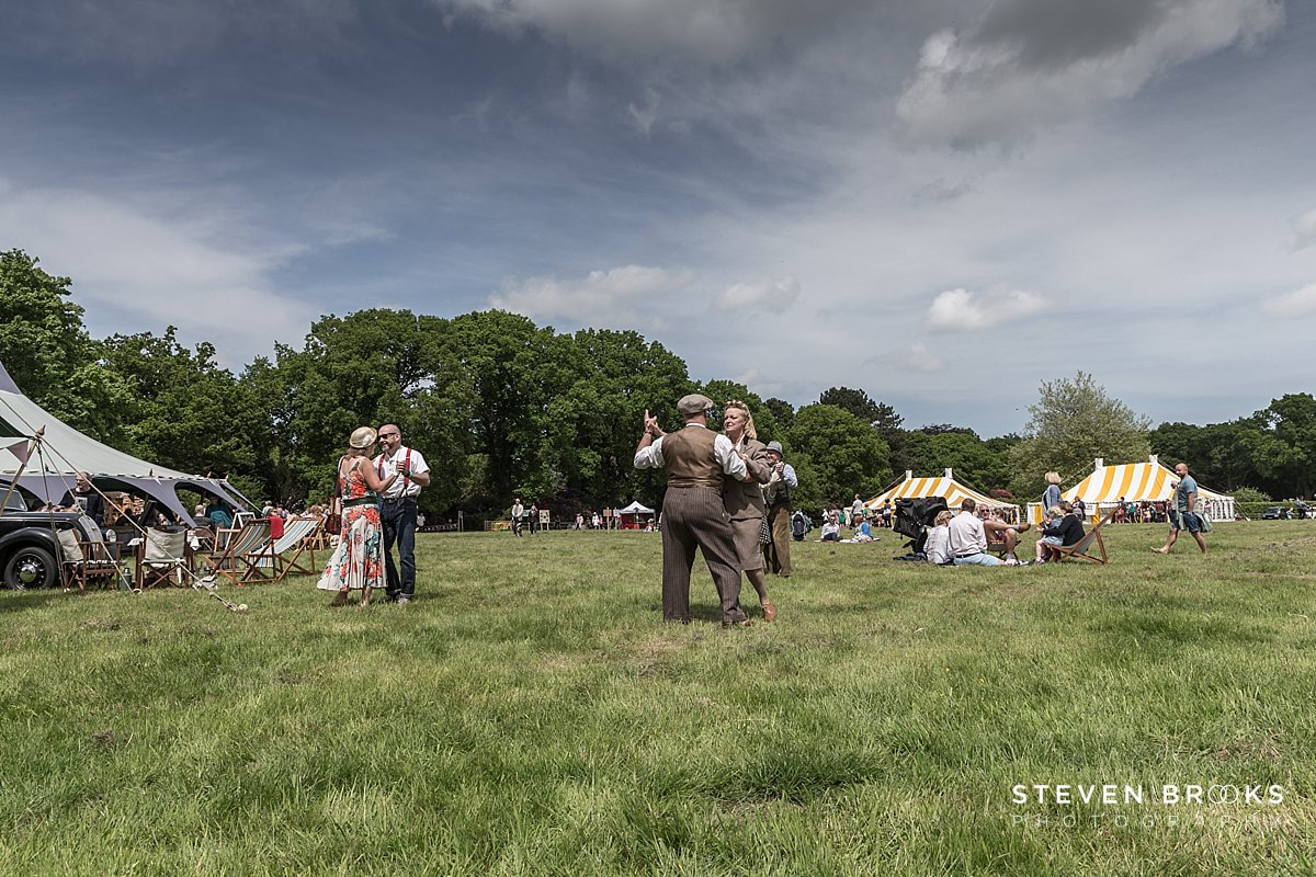 Norfolk photographer steven brooks photographs an overview of couples dancing in vintage clothes to 40's style music at Britain Does Vintage at Stody Lodge