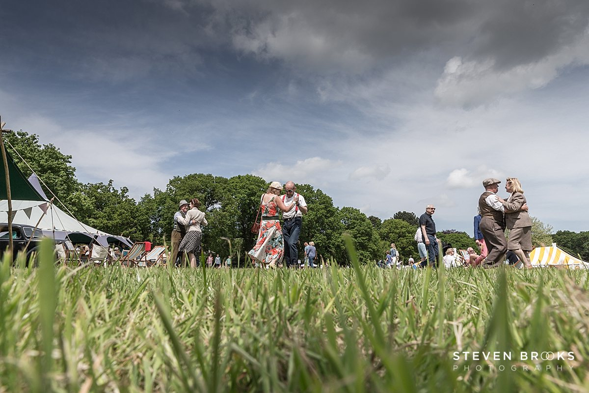 Norfolk photographer steven brooks photographs couples dancing from ground level in vintage clothes to 40's style music at Britain Does Vintage at Stody Lodge