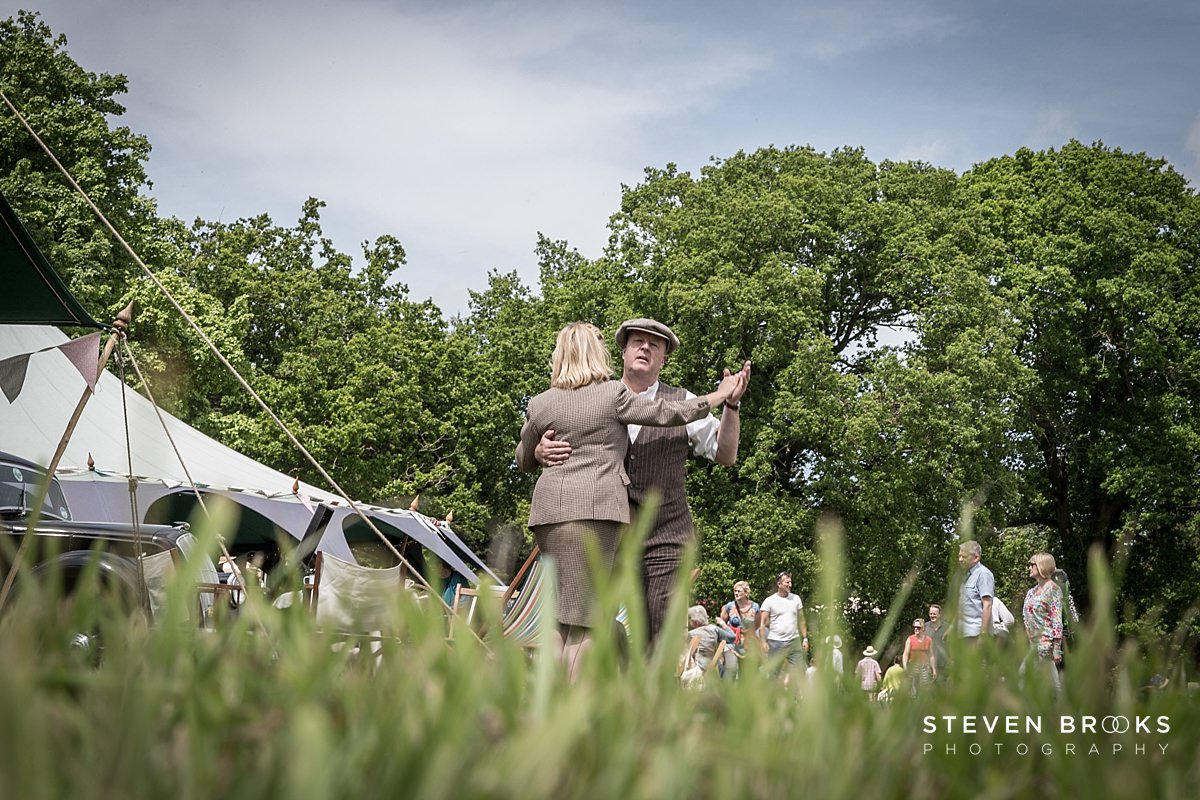Norfolk photographer steven brooks photographs couples dancing from ground level to 40's style music at Britain Does Vintage in Noirfolk