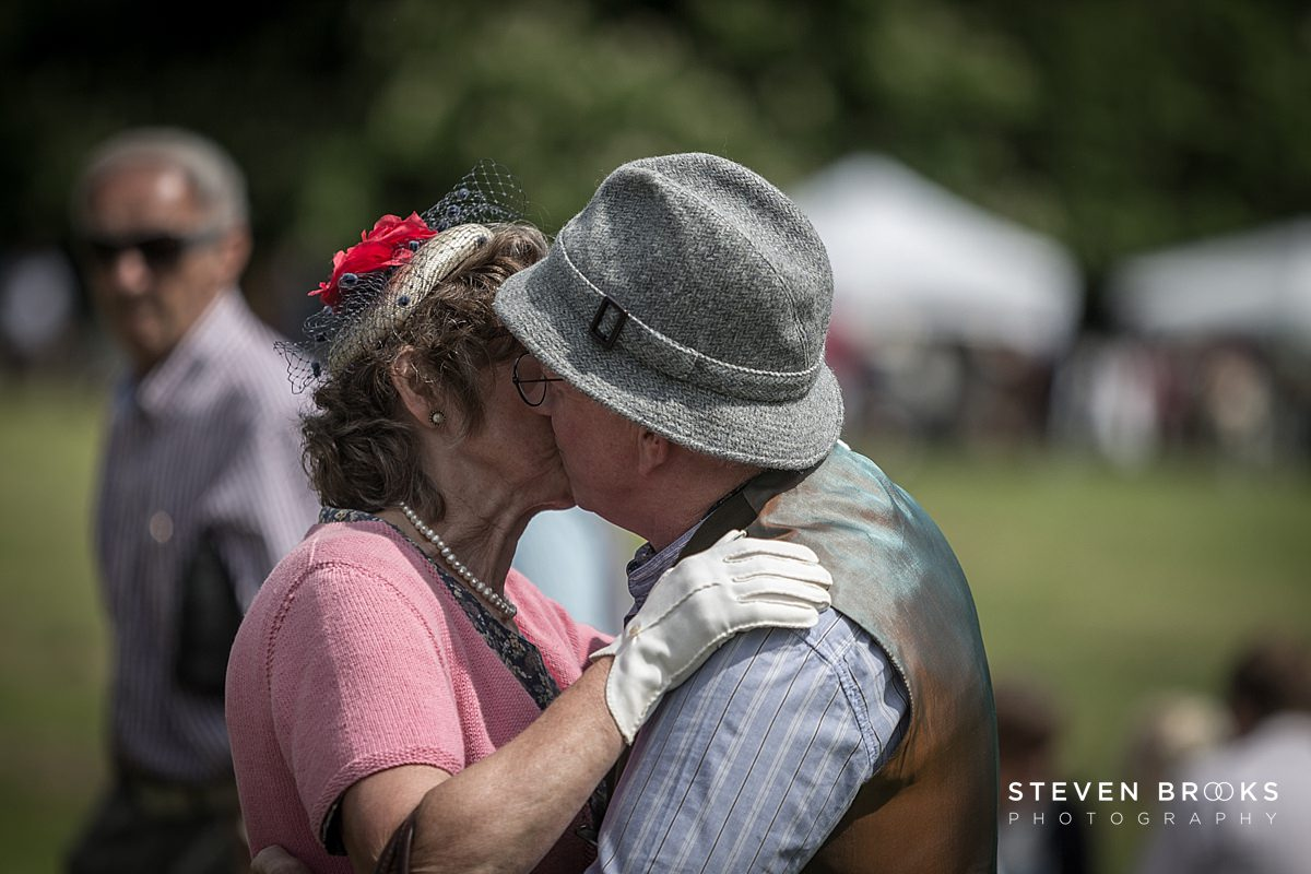 Norfolk photographer steven brooks photographs a couple dancing and kissing in vintage clothes at Britain Does Vintage in Noirfolk