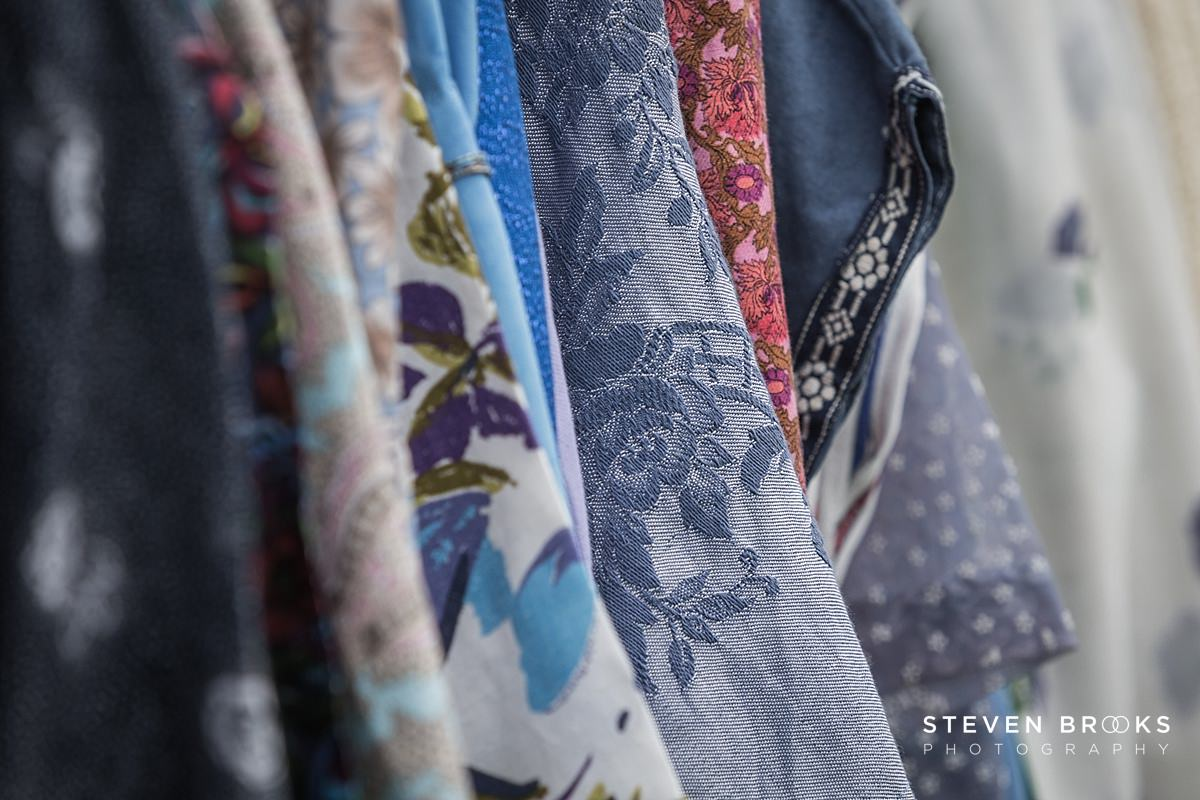 Norfolk photographer steven brooks photographs a rack of vintage clothes at Britain Does Vintage in Norfolk