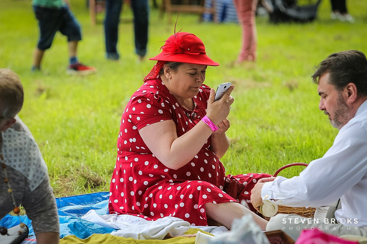 Norfolk photographer steven brooks photographs a lady in red at Britain Does Vintage in Norfolk