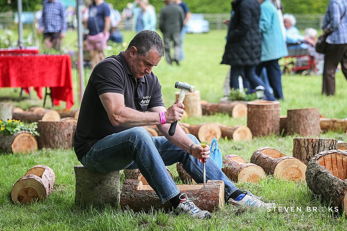 Norfolk photographer steven brooks photographs a wood craftsman at Britain Does Vintage in Norfolk