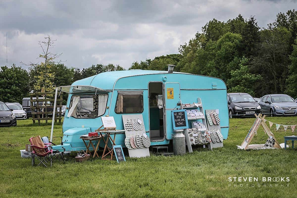 Norfolk photographer steven brooks photographs a blue caravan at Britain Does Vintage in Norfolk