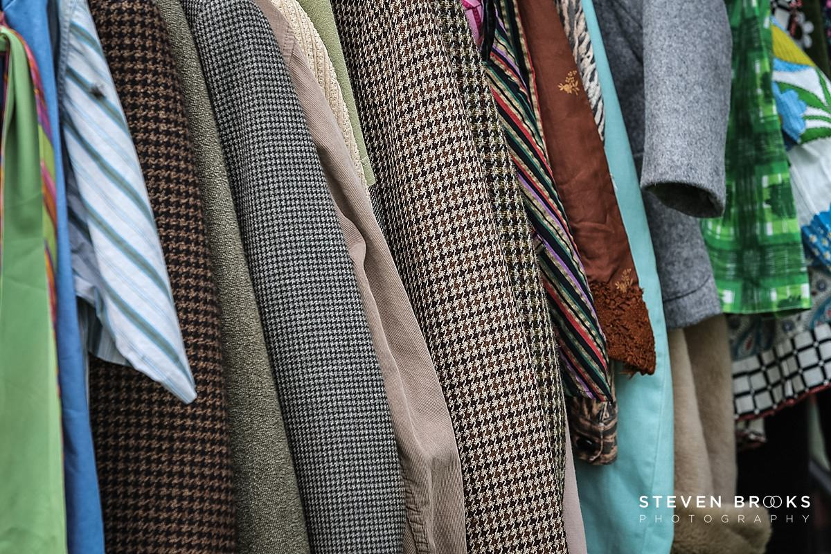 Norfolk photographer steven brooks photographs a of tweed jackets on a rack at Britain Does Vintage in Norfolk