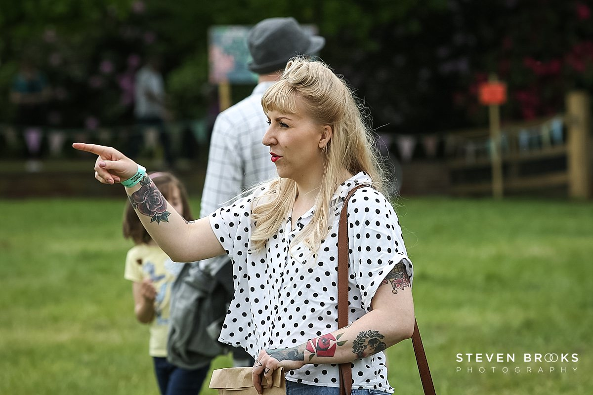 Norfolk photographer steven brooks photographs a tattooed woman with vintage hairstyle at Britain Does Vintage in Norfolk