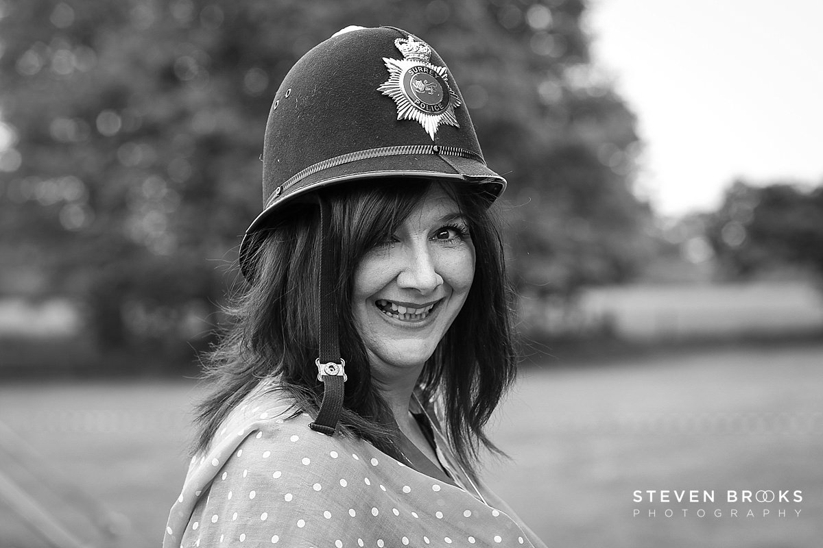 Norfolk photographer steven brooks photographs a womans in an old policemans helmet at Britain Does Vintage in Norfolk