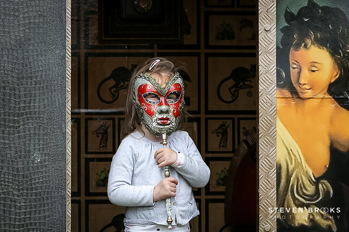Norfolk photographer steven brooks photographs a child holding a venetian mask at Britain Does Vintage in Norfolk