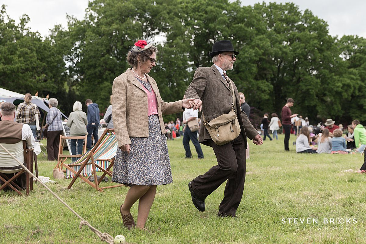Norfolk photographer steven brooks photographs a couple in vintage clothes demonstrating a dance at Britain Does Vintage in Norfolk