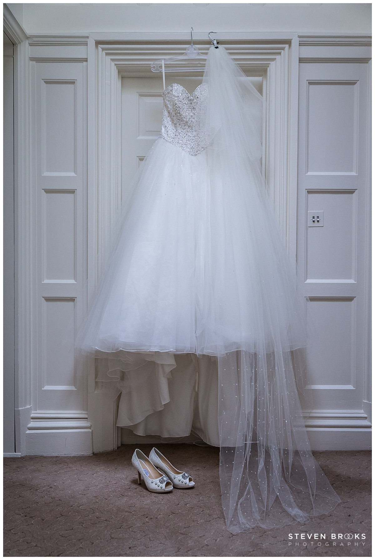 Leeds Castle wedding photographer steven brooks photographs wedding dress in the castle