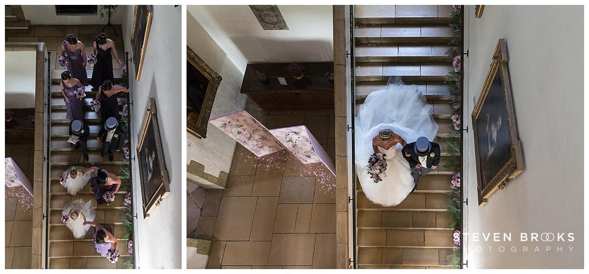 Leeds Castle wedding photographer steven brooks photographs bridal party walking down main staircase in Leeds Castle