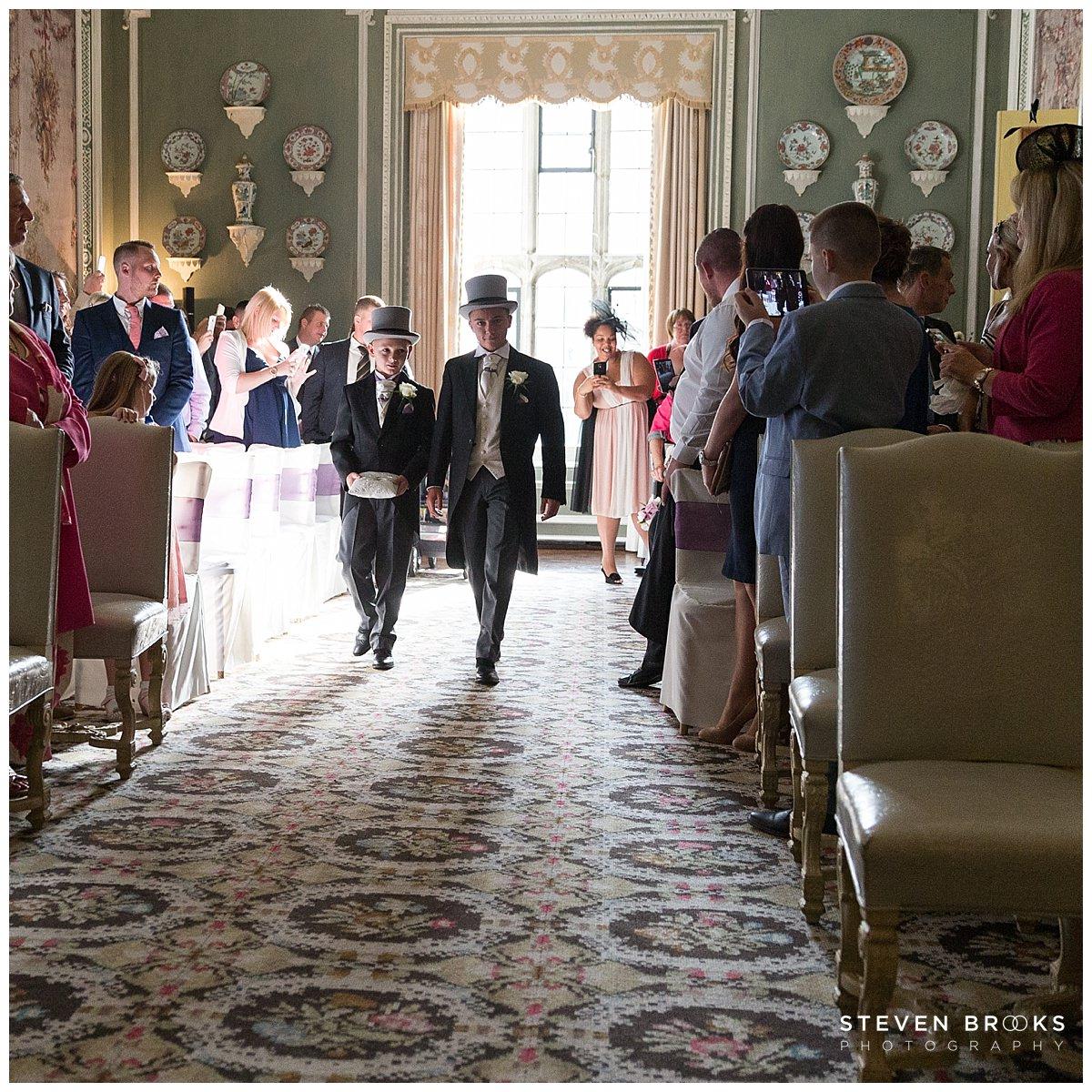 Leeds Castle wedding photographer steven brooks photographs bridal party entering the wedding cermony room