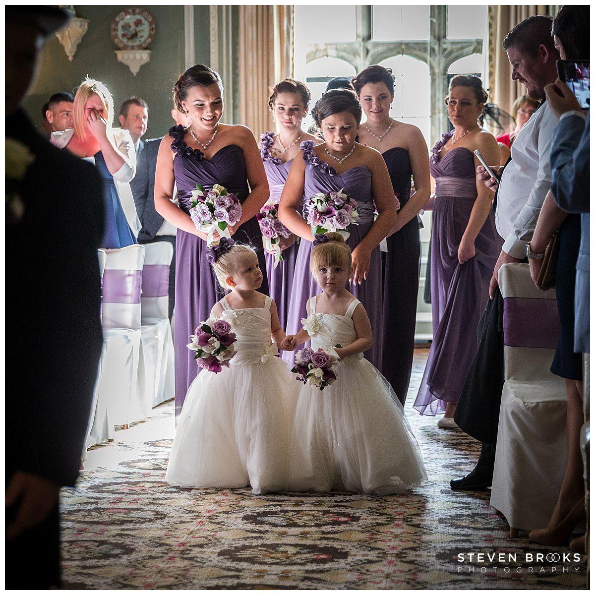 Leeds Castle wedding photographer steven brooks photographs the bridal party entering the wedding ceremony room