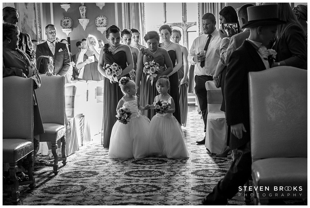 Leeds Castle wedding photographer steven brooks photographs the entrance of the bridal party into the wedding ceremony room