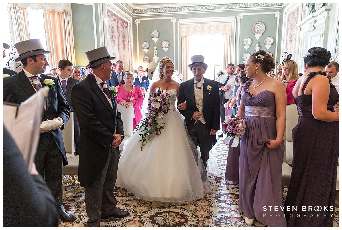 Leeds Castle wedding photographer steven brooks photographs the entrance of the bride into the wedding ceremony room
