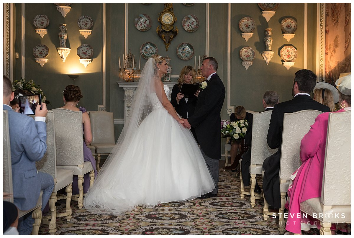 Leeds Castle wedding photographer steven brooks photographs the bride and groom in the wedding ceremony room at Leeds Castle