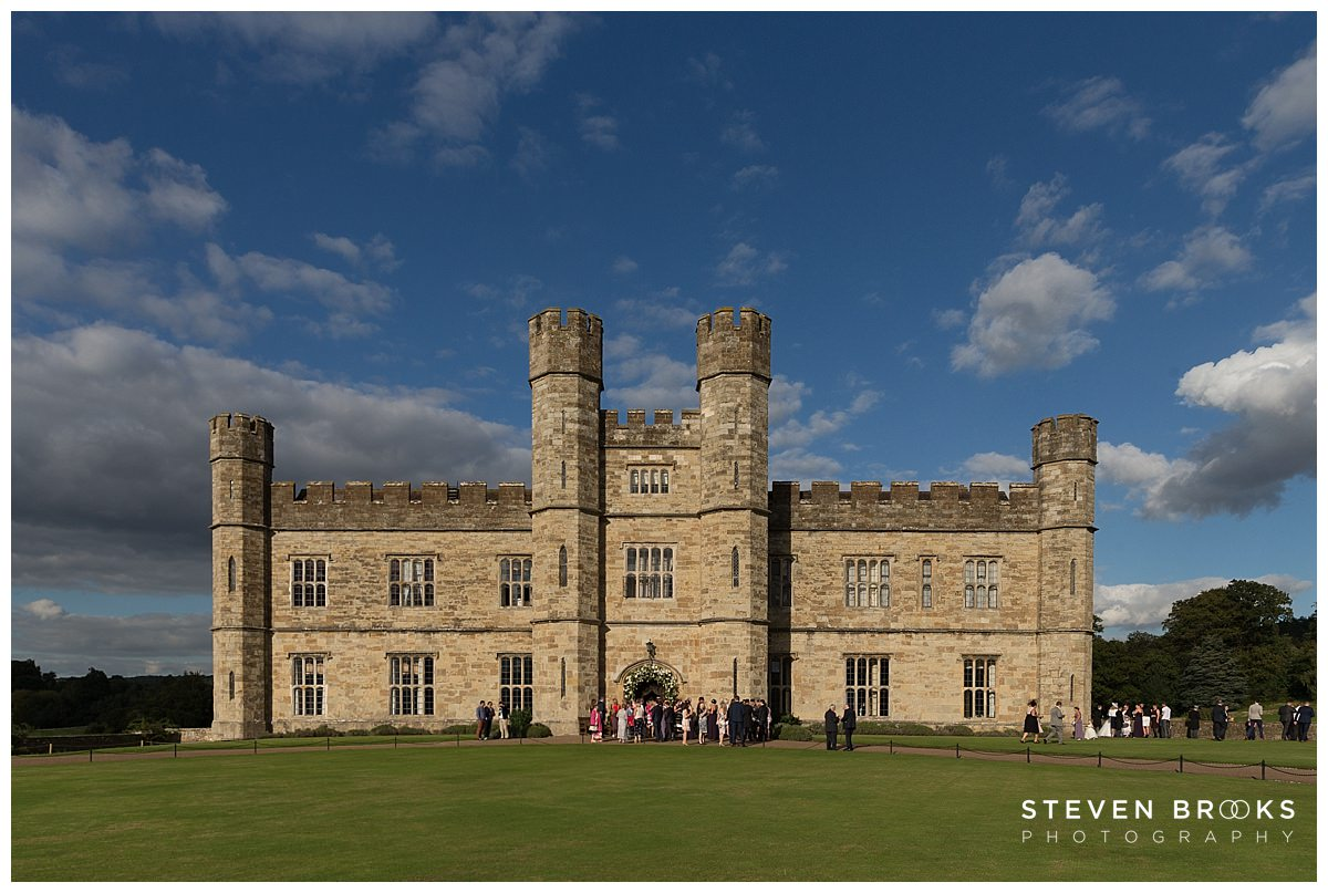 Leeds Castle wedding photographer steven brooks photographs Leeds Castle with wedding guests outside