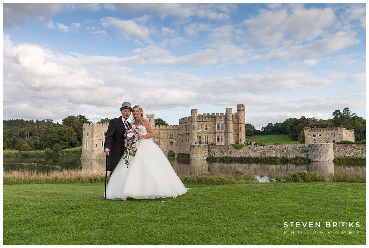 Leeds Castle wedding photographer steven brooks photographs the bride and groom in thegrounds of Leeds Castle