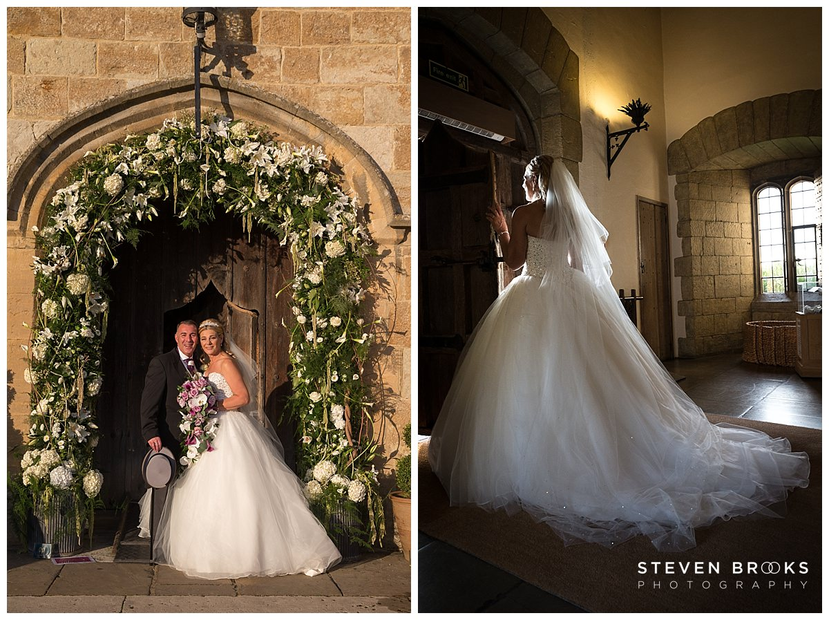Leeds Castle wedding photographer steven brooks photographs the bride and groom at the main door at Leeds Castle
