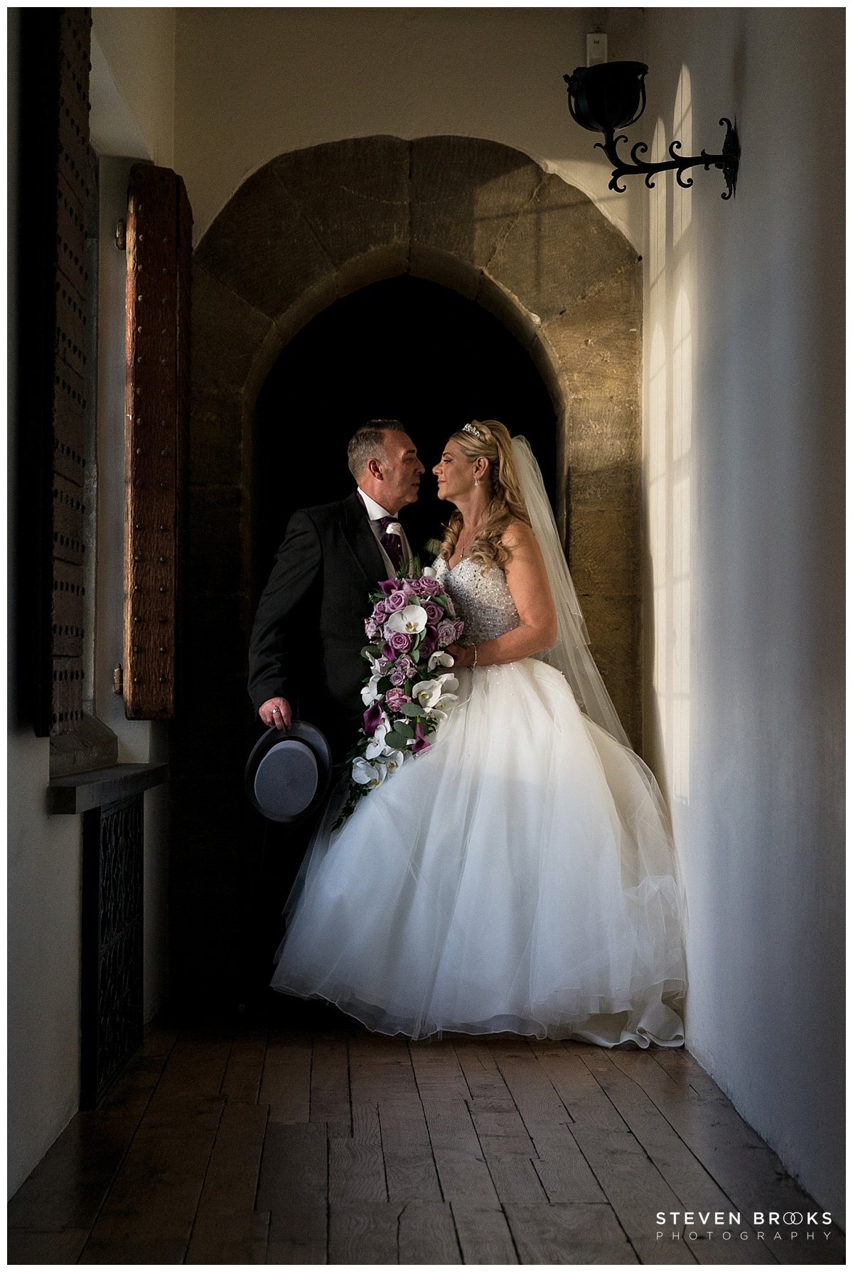 Leeds Castle wedding photographer steven brooks photographs the bride and groom the evening light at Leeds Castle