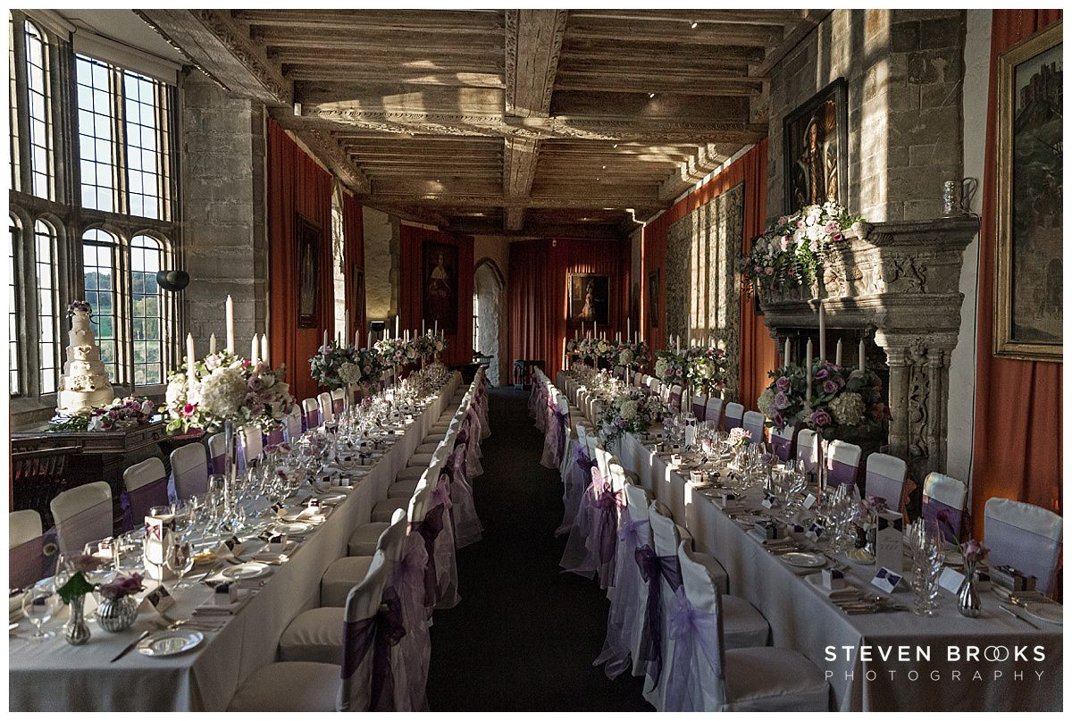 Leeds Castle wedding photographer steven brooks photographs the wedding breakfast room at the Henry VIII banquetting hall at Leeds Castle
