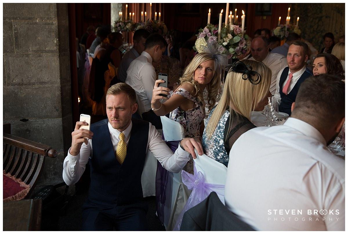 Leeds Castle wedding photographer steven brooks photographs wedding guests taking photos at Leeds Castle