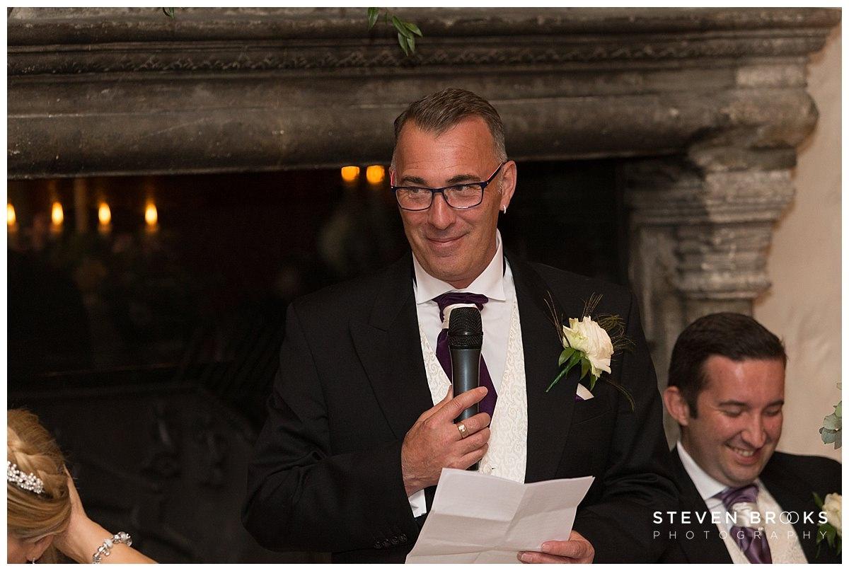 Leeds Castle wedding photographer steven brooks photographs the groom during the wedding breakfast making his speech at Leeds Castle