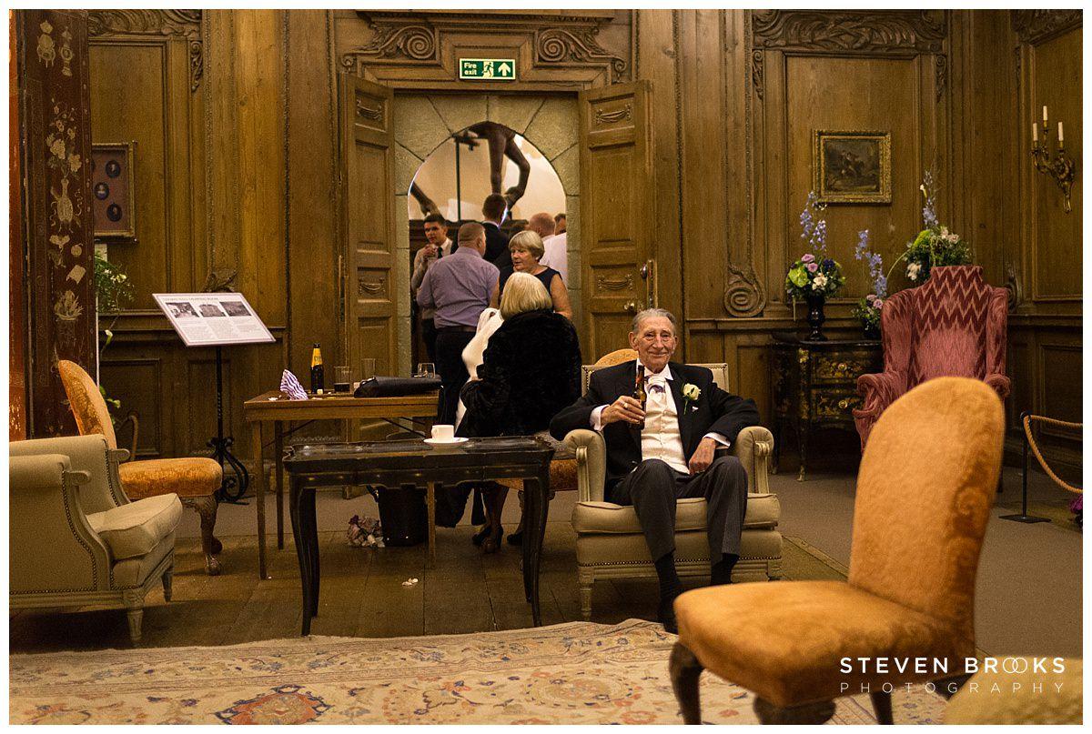Leeds Castle wedding photographer steven brooks photographs a guest after the wedding breakfast at Leeds Castle