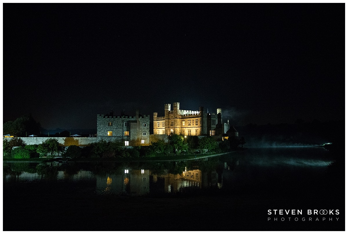 Leeds Castle wedding photographer steven brooks photographs Leeds Castle at night across the moat with reflections
