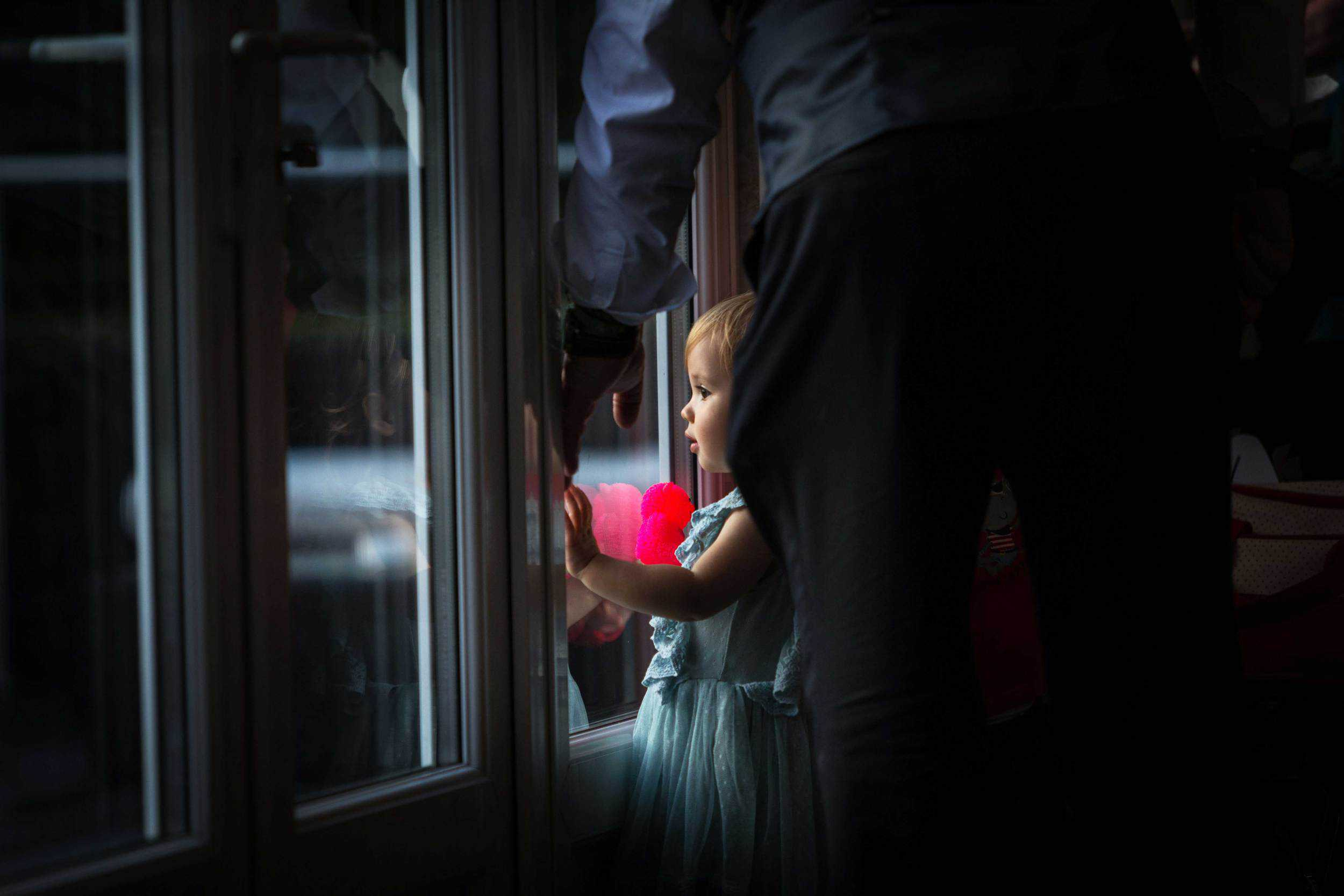 little girl looking out of a window at chippenham park
