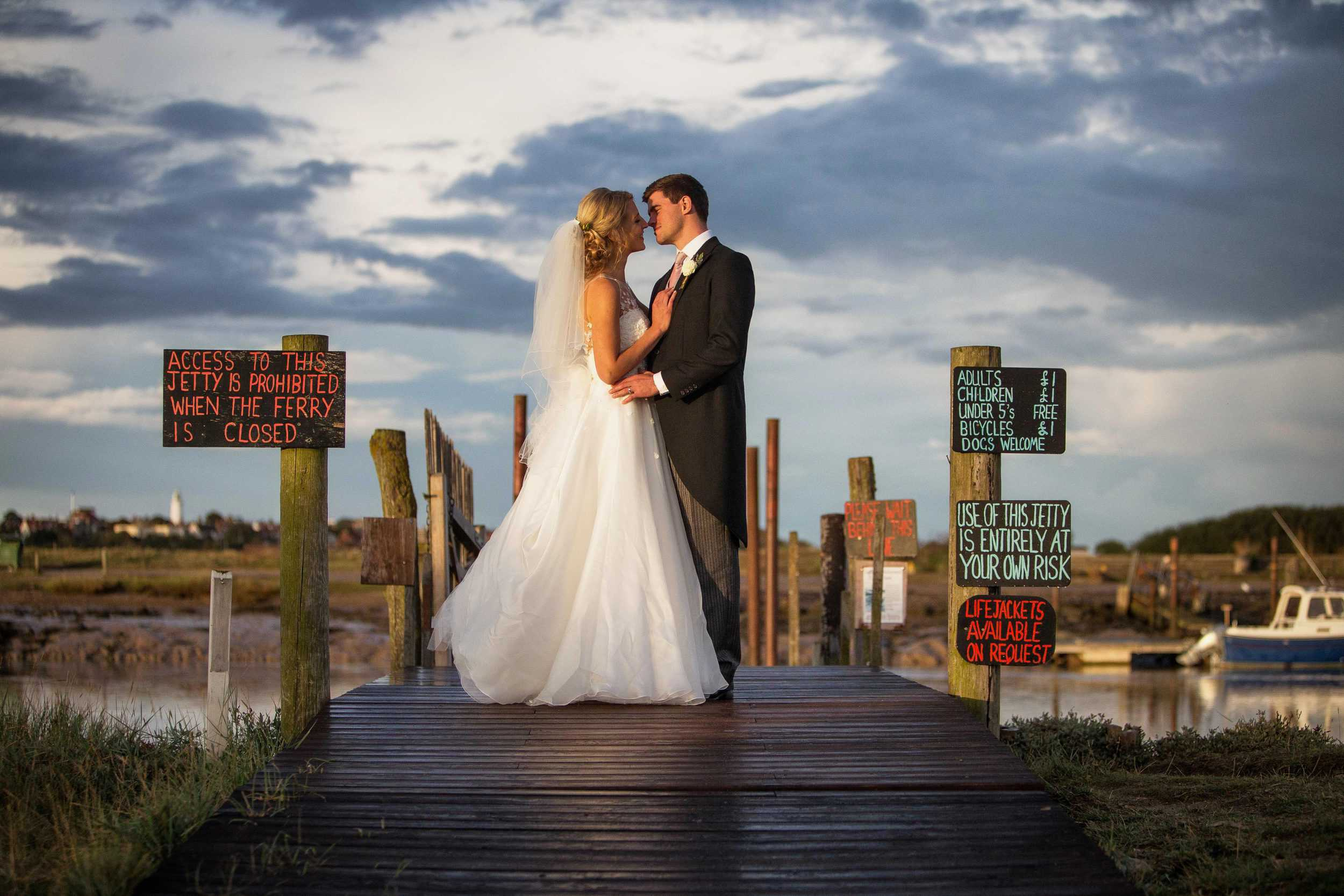 bride and groom on jetty in Walberwick