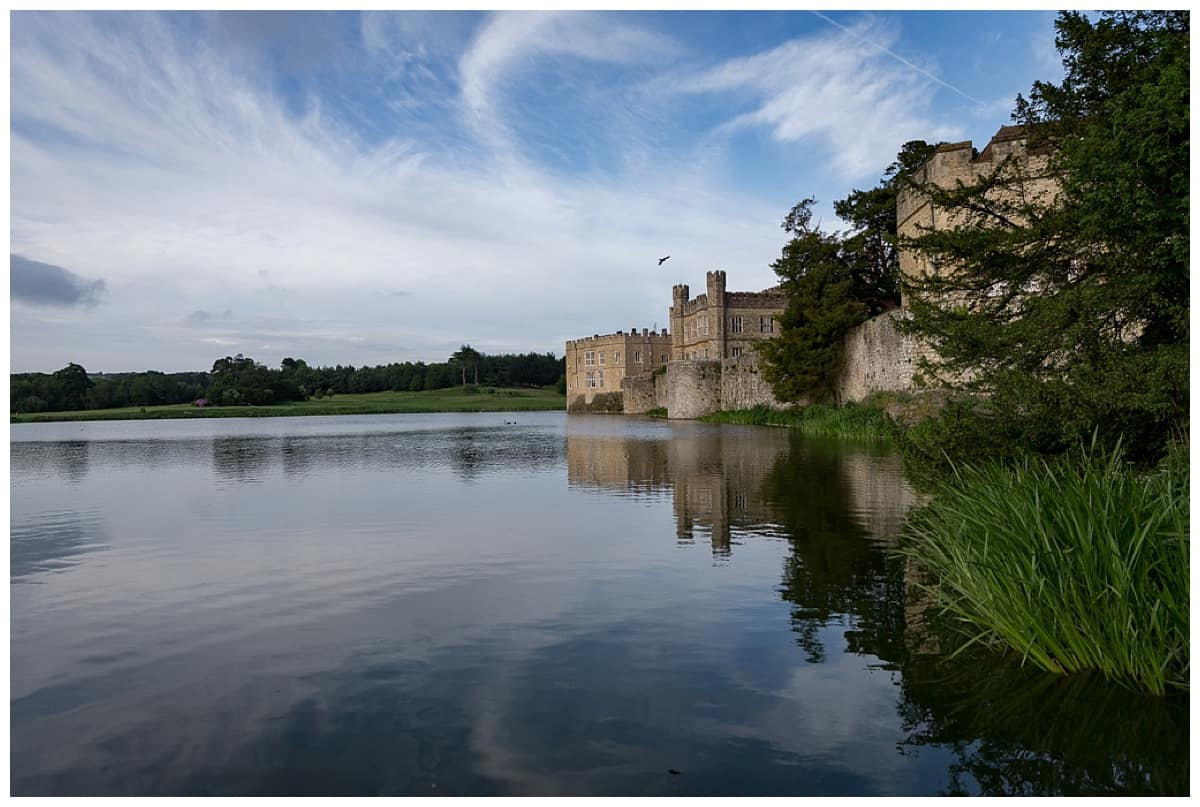 late afternoon at leeds castle with reflections in the moat