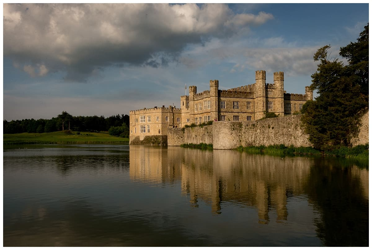 leeds castle by the moat as the sun is setting